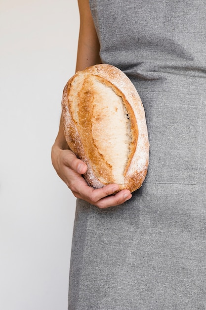 Person holding freshly baked bread Free Photo