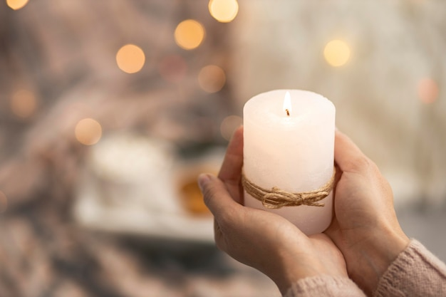 Person holding lit candle with copy space Premium Photo