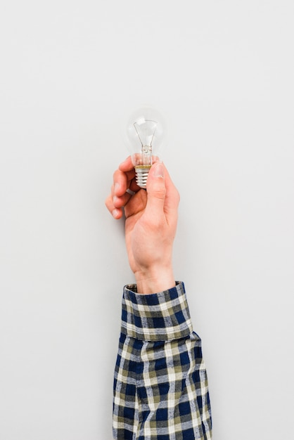 Person holding simple light bulb Free Photo