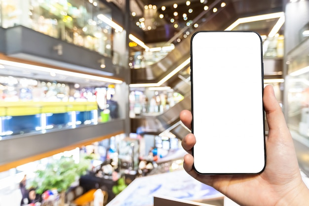 Person holding smartphone with blank screen Premium Photo