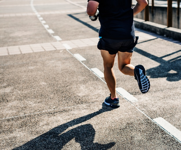 Person jogging at park Free Photo
