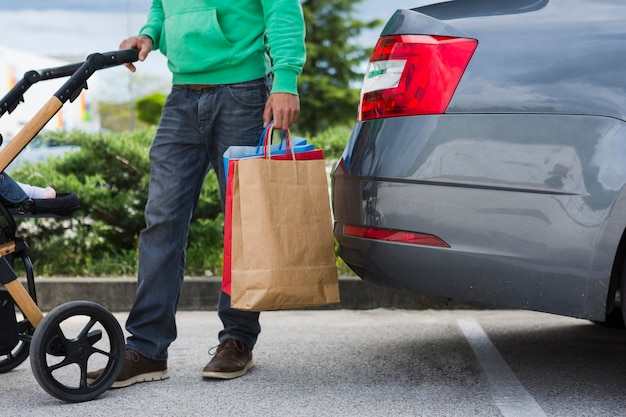 Person keeping shopping bags inside the car Free Photo