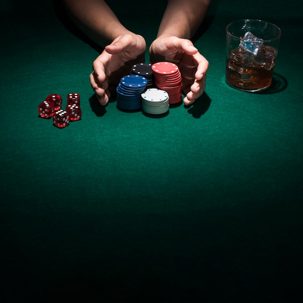A person playing poker in casino Free Photo