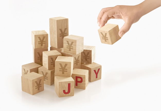Person playing with wooden to blocks Premium Photo