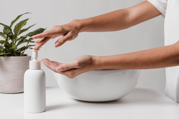 Person pouring soap in hand Premium Photo