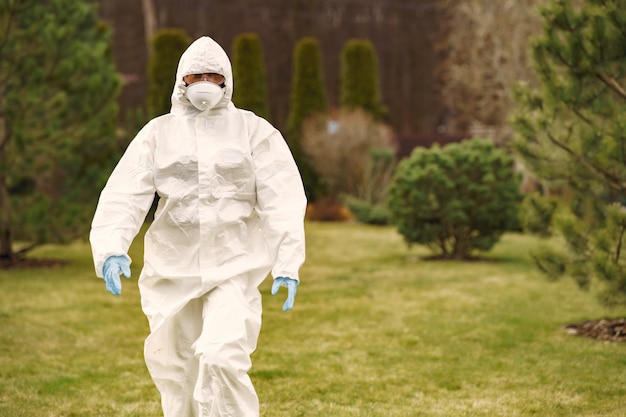 Person in a protective suit in a park Free Photo