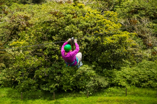A person riding zip line over rainforest at costa rica Free Photo