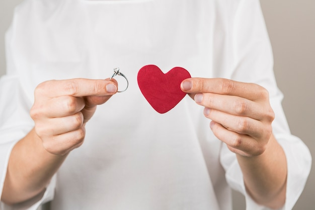 Person showing decorative vinous heart and ring Free Photo
