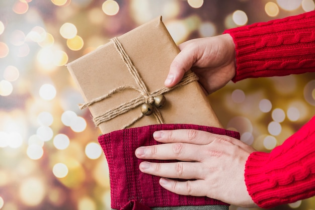 Person taking gift from christmas sock Free Photo