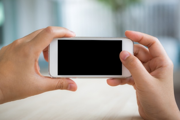 Person taking a photo with the mobile Free Photo