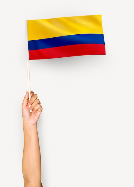 Person waving the flag of republic of colombia Free Photo