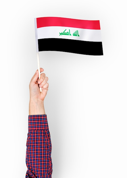 Person waving the flag of republic of iraq Free Photo