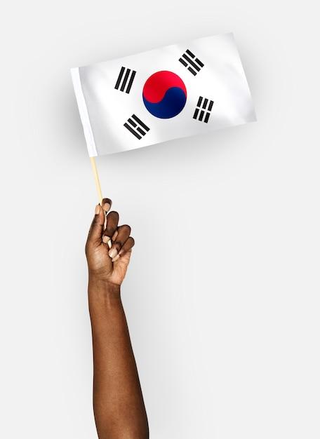 Person waving the flag of south korea Free Photo