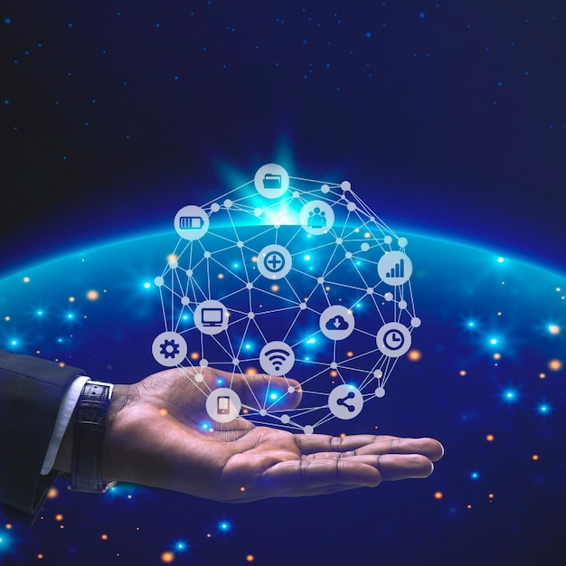 Person with connection icons on top of his hand Free Photo