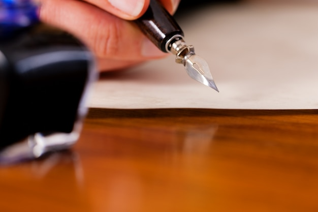 Person Writing A Letter from image.freepik.com