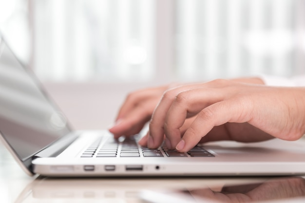 person writing on a laptop photo free download