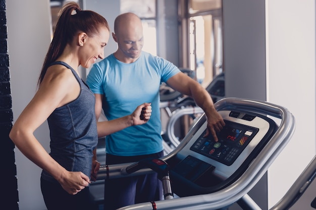 Personal training with a trainer on a treadmill Premium Photo