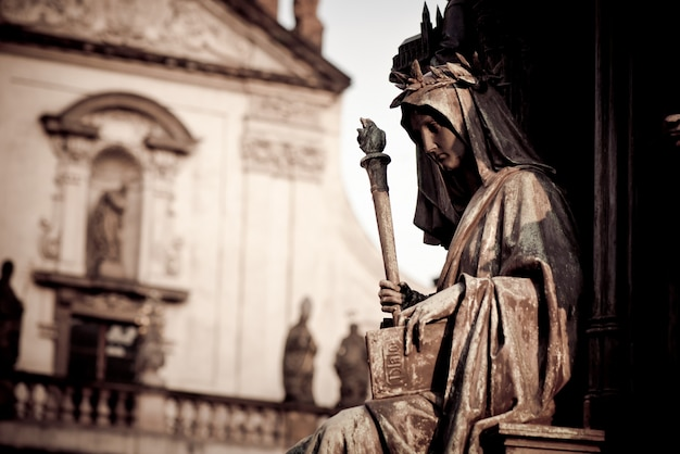 Personification of the faculty of arts, decoration of the statue of charles iv. prague, czech republic Premium Photo