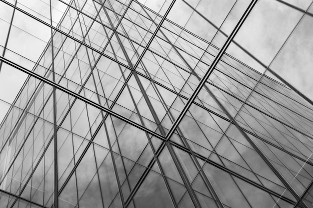 Perspective of modern glass window at skyscrapers - monochrome Premium Photo