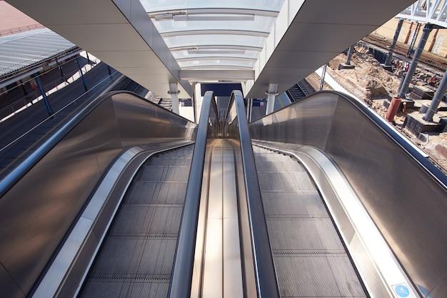 Perspective view on escalator on railway station Premium Photo