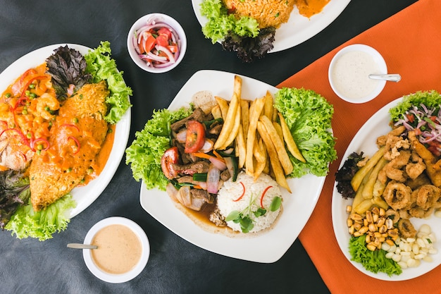 Peruvian food, seafood, french fries and sauces Premium Photo