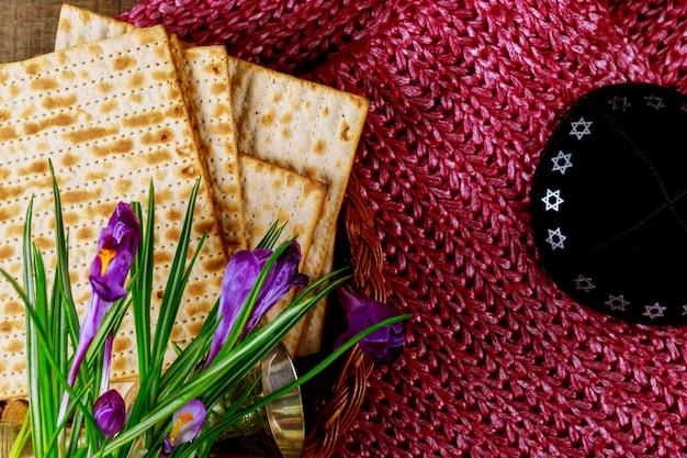 Pesach passover symbols of great jewish holiday. traditional matzoh, matzah or matzo Premium Photo