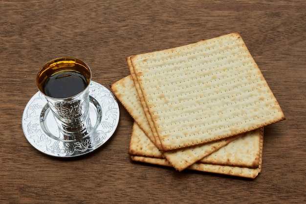 Pesach still-life with wine and matzoh jewish passover bread Premium Photo