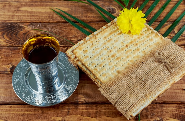 Pesach still-life with wine and matzoh jewish passover bread Premium Photo