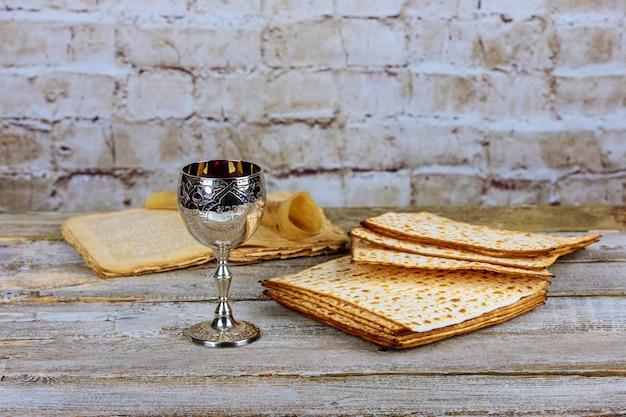 Pesah celebration and torah scroll during jewish passover holiday . Premium Photo