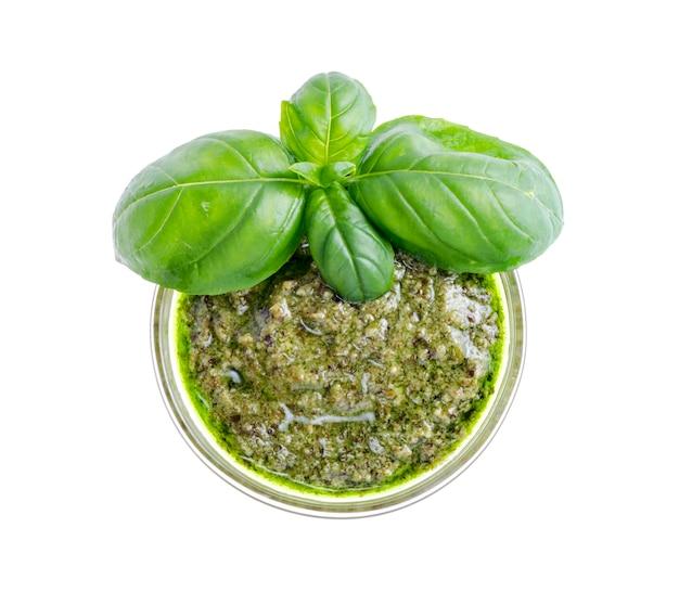 Pesto sauce and fresh green basil leaves. Premium Photo
