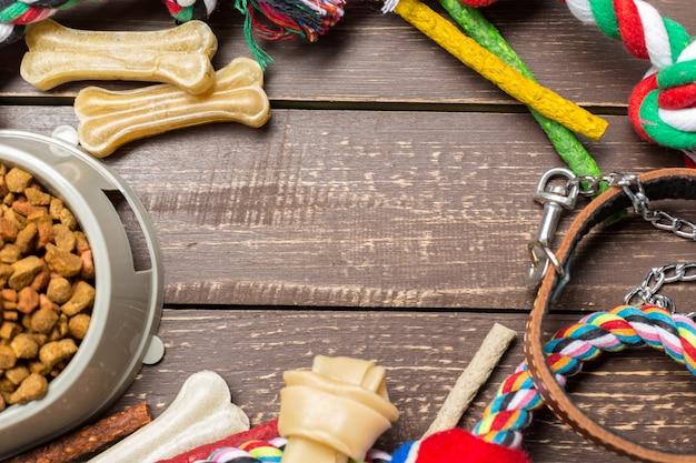 Pet accessories, food, toy. top view Premium Photo