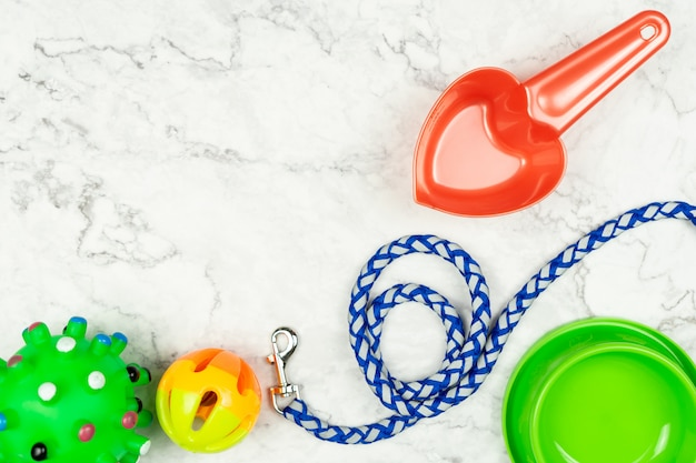 Pet bowl, leashes, and toy for dog. pet accessories concept. Premium Photo