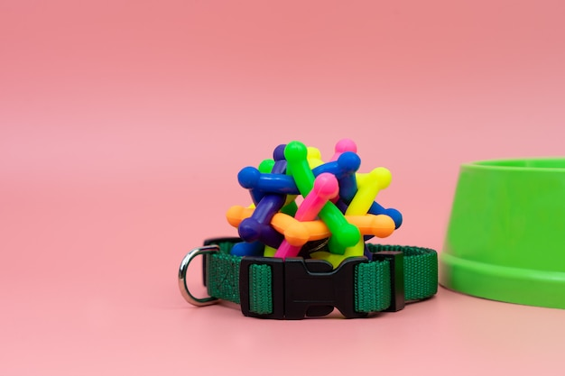 Pet collar and rubber toy with bowl Premium Photo
