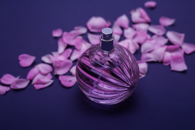 Petals roses and glass perfume Premium Photo
