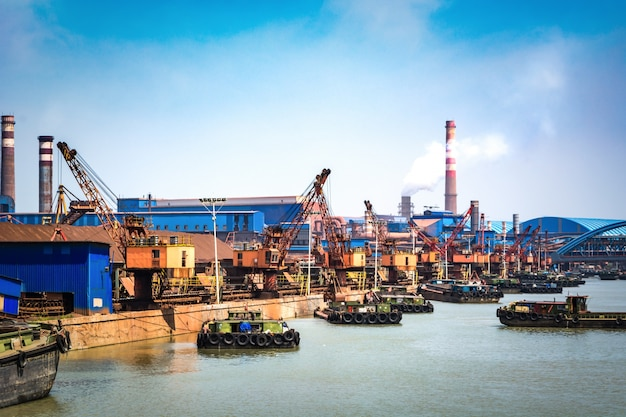 Petroleum gas container ship and oil refinery background for energy nautical transportation Free Photo