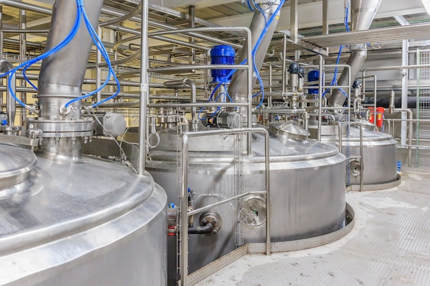 Pharmaceutical factory equipment mixing tank on production line in pharmacy industry Premium Photo