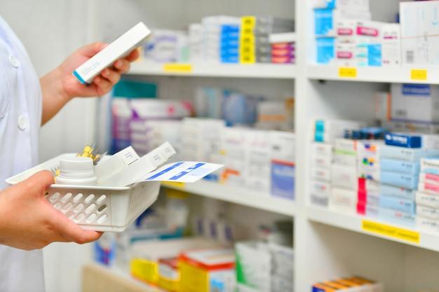 Pharmacist filling prescription in pharmacy drugstore Premium Photo