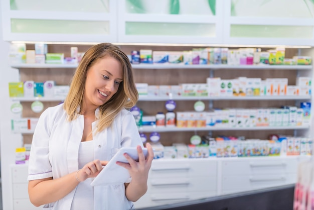 Pharmacist use tablet to drug store management. Premium Photo