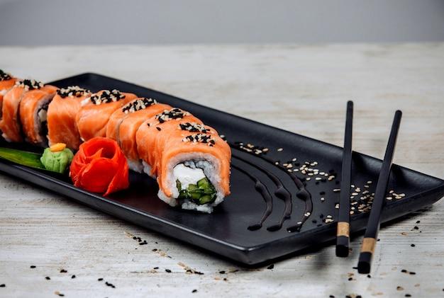 Philadelphia rolls with salmon and cucumber Free Photo