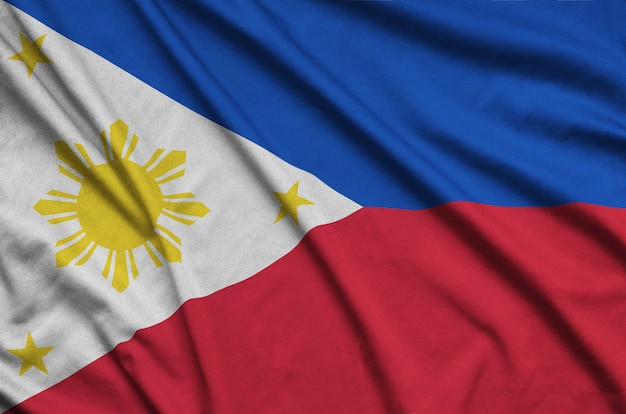 Philippines flag  is depicted on a sports cloth fabric with many folds. Premium Photo