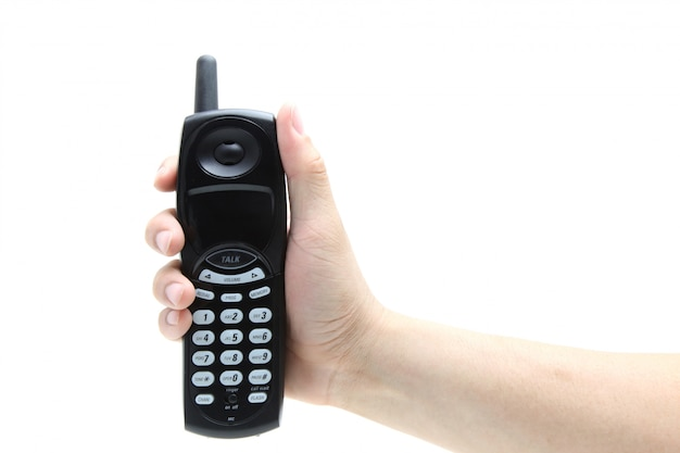 Phone in the hand isolated on white Premium Photo