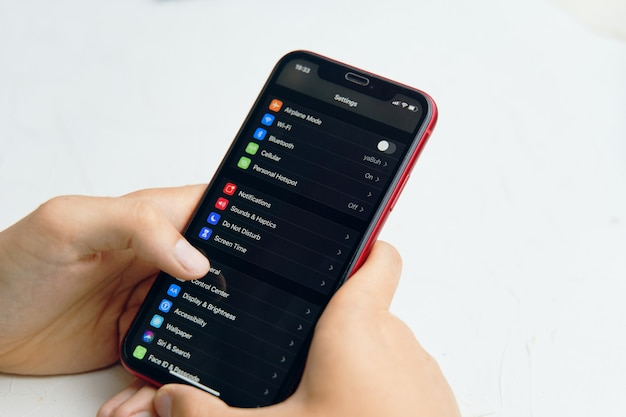 Phone in hand. settings phone on screen display. Premium Photo