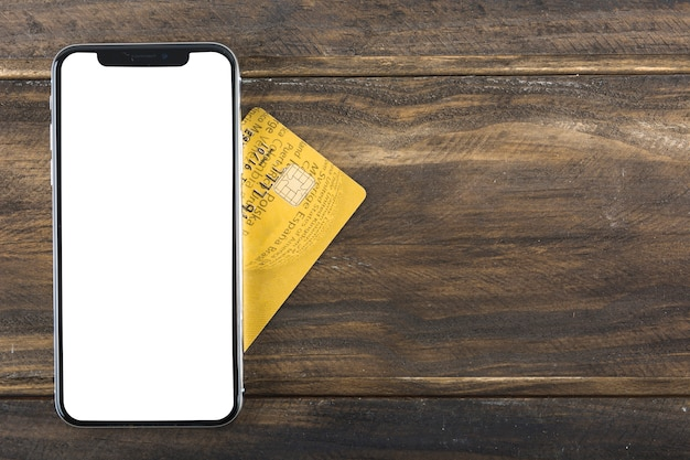 Phone with credit card on table Free Photo