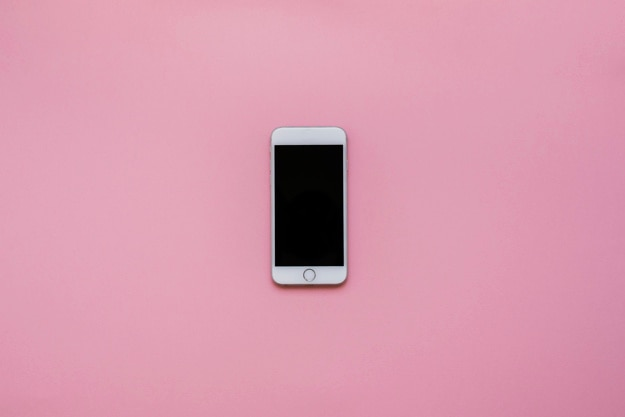 Phone with pink background Free Photo