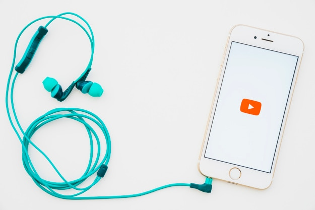 Phone with youtube app and earphones Photo   Free Download