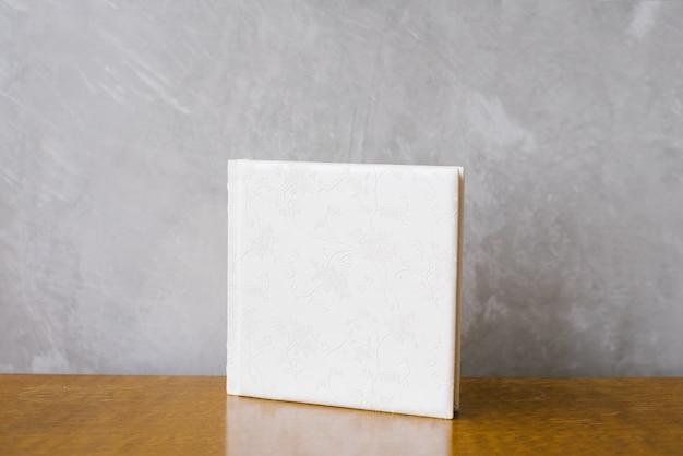 Photo book in a white leather cover. wedding photoalbum Premium Photo