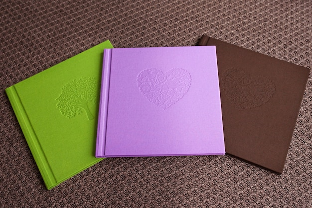 Photo books with textile cover.  bright color, organic cotton, cover with decorative stamping. Premium Photo