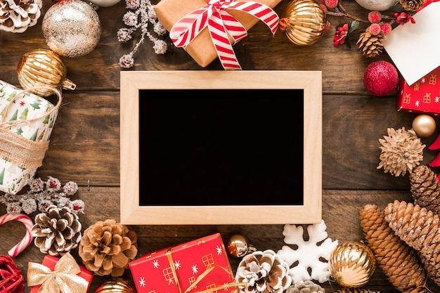 Photo frame between christmas decorations Free Photo