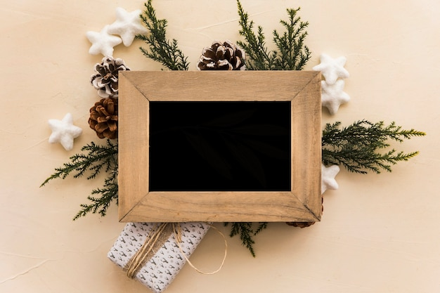 Photo frame on composition of snags and coniferous twigs Free Photo