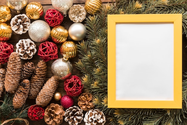 Photo frame between fir branches, ornament snags and christmas balls Free Photo